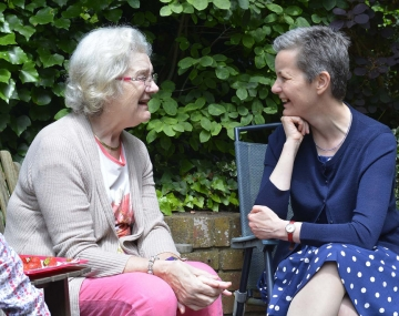 Two elderly women sitting chatting